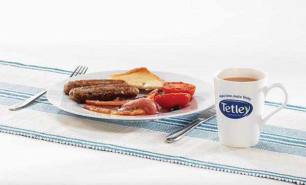 Cooked breakfast with mug of Tetley tea
