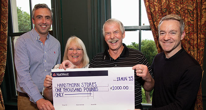 The Frasers receive cheque from Antony Begley
