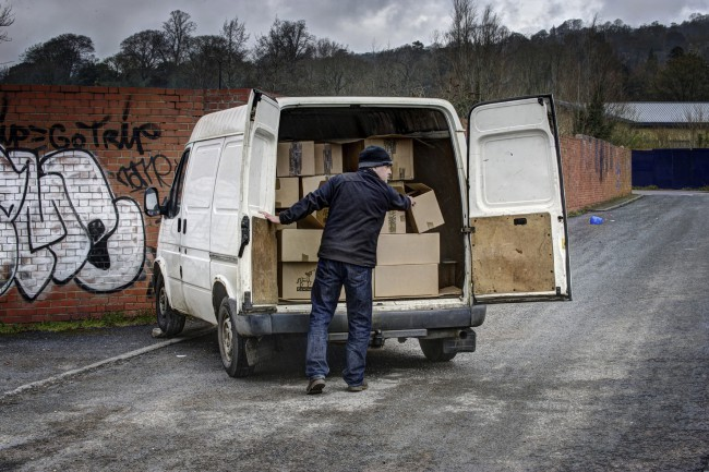 Dodgy geezer unloading van