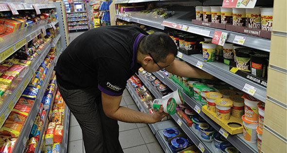 Shopworker stacking shelves