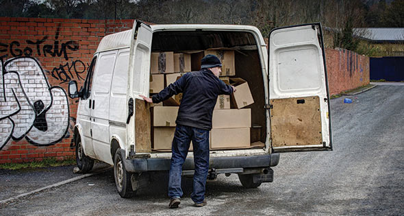 Suspicious character unloading boxes from an unmarked van