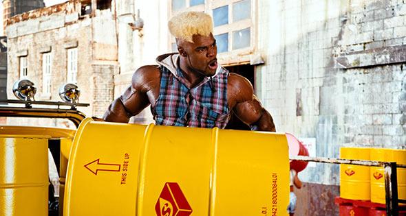 Bodybuilder lifting oil drum full of Starburst flavour
