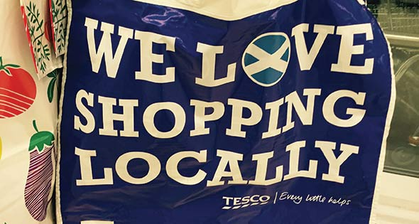 "Tesco carrier bag saying ""We love shopping locally""."