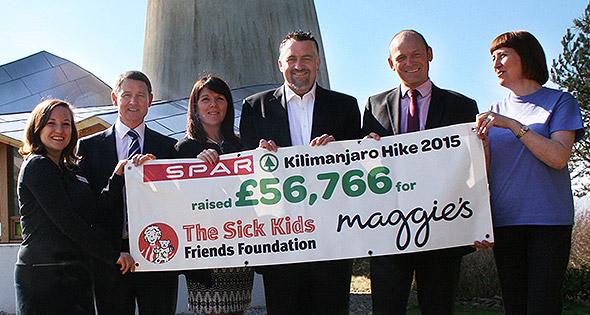Spar team present cheque for £56,766