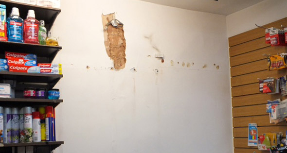 Shop's internal wall showing clear signs of a fixture removal
