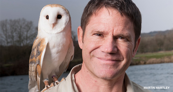 Steve Backshall with owl perched on his shoulder