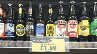 Bottles of craft beer on shop shelf