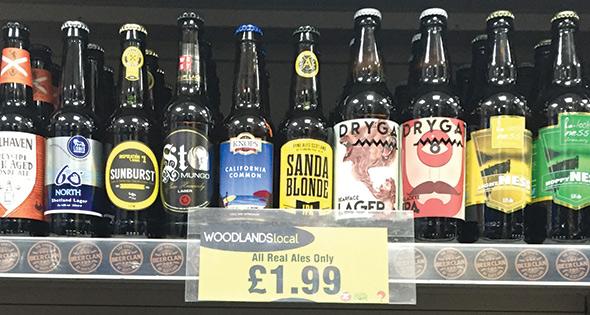 Bottles of craft beer on shop shelf