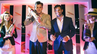 Mark Ronson shakes bottle of Mumm champagne