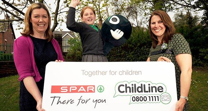 Spar presents cheque to ChildLine