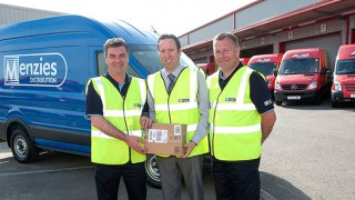 Menzies Distribution and AJG Parcels staff holding a package