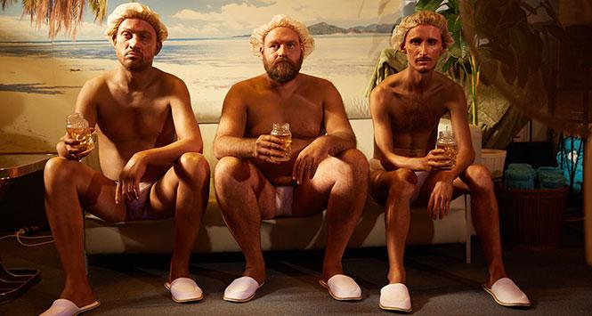 Men in tanning salon drinking Southern Comfort