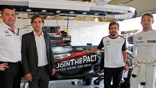 Jenson Button and Fernando Alonso next to 'Join the pact' branded racing car