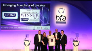 One Stop collects its Franchisor of the year award