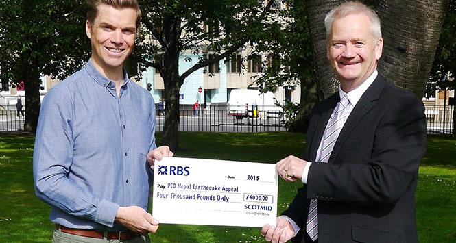 Scotmid £4,000 cheque presented to DEC