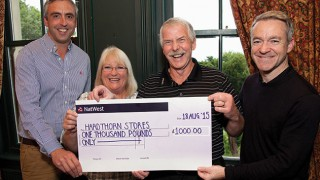 Maureen and Ewan Fraser receive cheque from Antony Begley