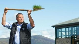 Alan Winchester holds spade aloft