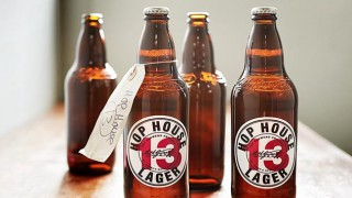 Bottles of Hop House 13 lager