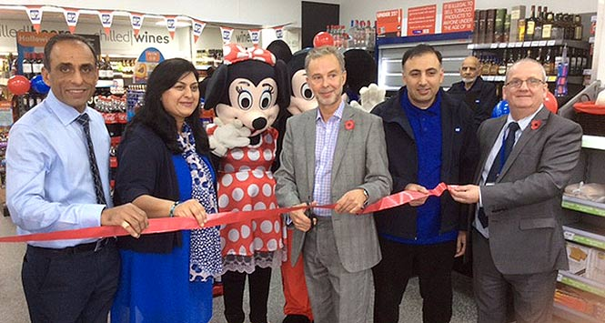 Cutting the ribbon at new store
