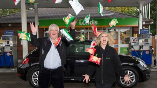 Lennart Palleson celebrates with Londis worker