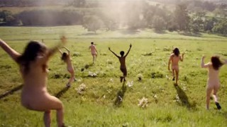 Naked people running through field