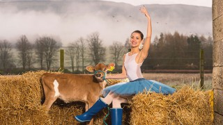 Ballet dancer with cow