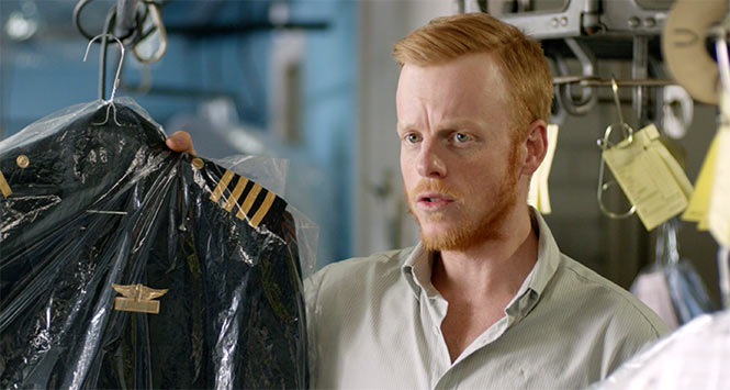 Man working in drycleaners