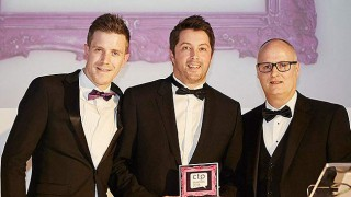 Imperial Tobacco team collect award