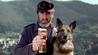 Eric Cantona, a pint of Kronenbourg and a large dog