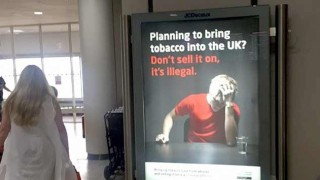 Anti-tobacco smuggling poster in airport