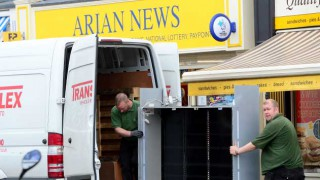 loading Arian News' tobacco gantry into a van