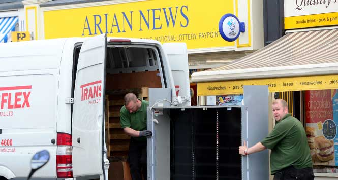 loading Arian News' tobacco gantry into a van