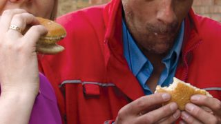 Eating a roll on sausage