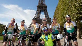 GroceryAid's London to Paris cyclists pose under the Eiffel tower