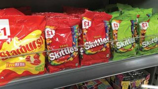 price-marked packs of Skittles