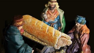 Greggs sausage roll in manger