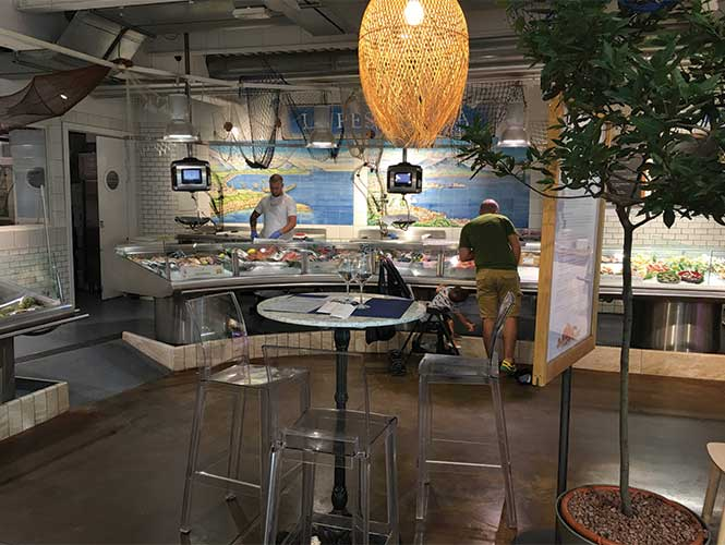 The longest fish counter we've ever seen offers a bewildering array of fish and seafood.