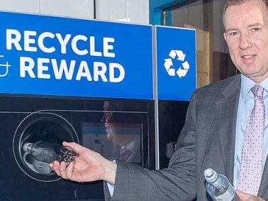 John Brodie feeds reverse vending machine