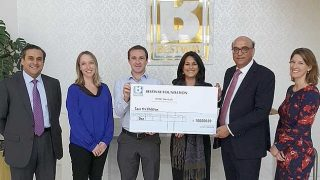 Save the Children cheque presentation