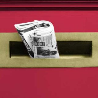 newspaper in letterbox