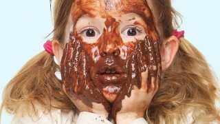 girl covered in chocolate sauce