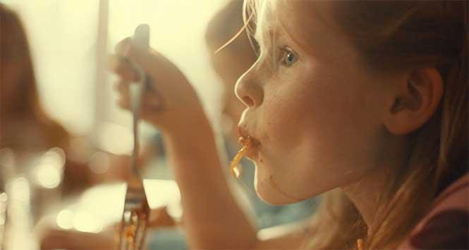 Cute kid eating spaghetti