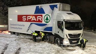 Spar lorry getting dug out of snow