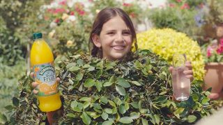 Child in hedge