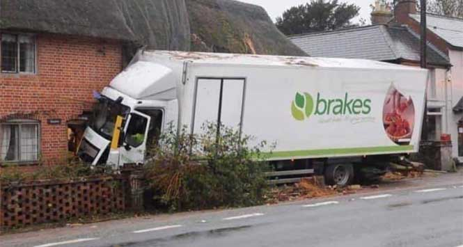 Brakes lorry crashed into side of house