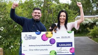 Couple holding giant cheque