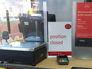 Position closed sign on post office counter